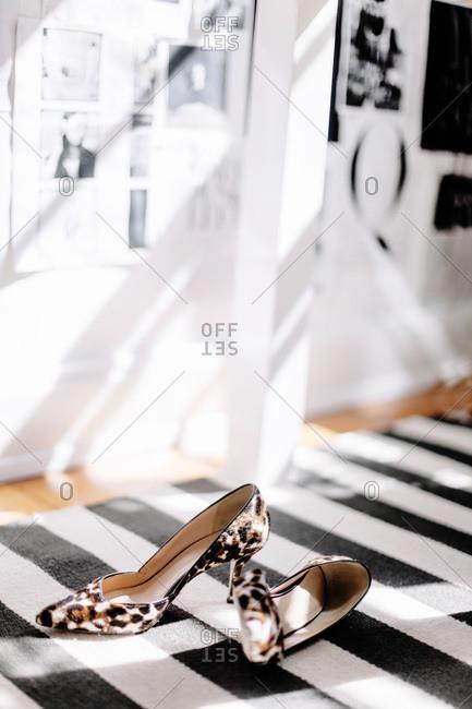 Leopard print heels on a striped rug