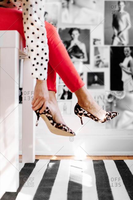 Woman putting on leopard print high heels