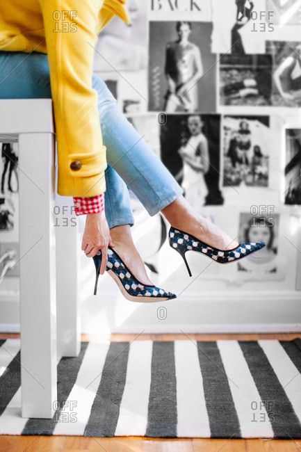 Woman putting on polka dot high heels