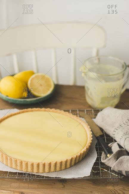 Lemon tart on a rustic wooden table