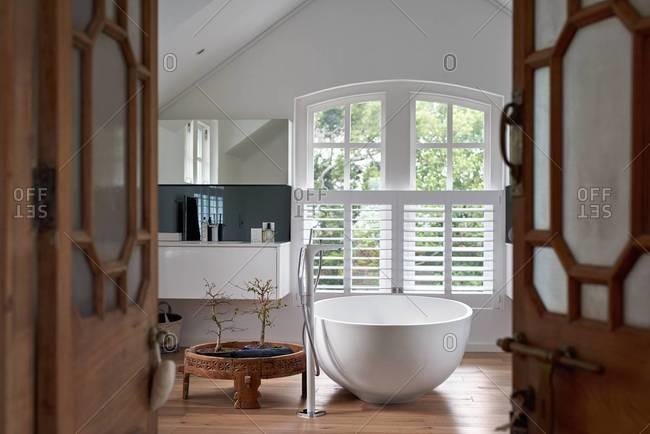 Stylish bathroom with modern designer bathtub