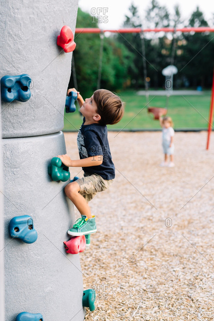 Boy on a climbing wall at a playground