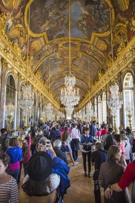 Versailles, France - September 20, 2015: Tourists in the Hall of Mirrors inside the Palace of Versailles