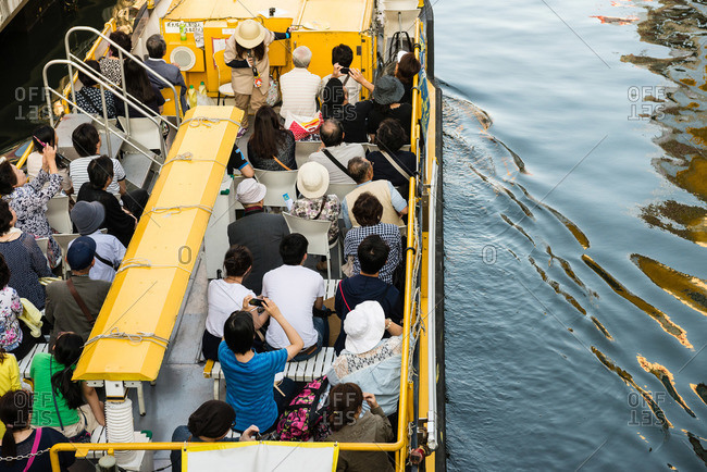Osaka, Japan - September 27, 2014: Tour boat on Dotonbori canal
