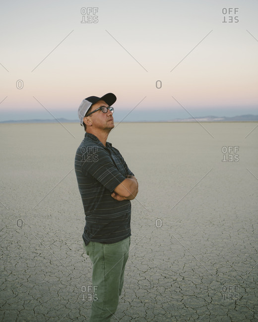 Middle aged man taking in the view and looking around at dawn in  Black Rock Desert, Nevada