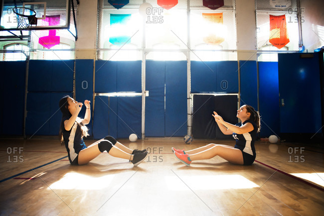 Two girls warming up for volleyball