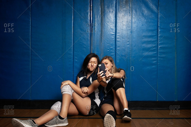 Teen volleyball players taking a selfie