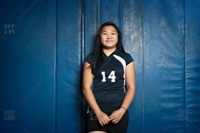 A teen female volleyball player