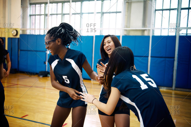 Girls laughing at volleyball practice