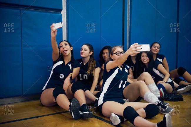 Female volleyball teammates taking selfie