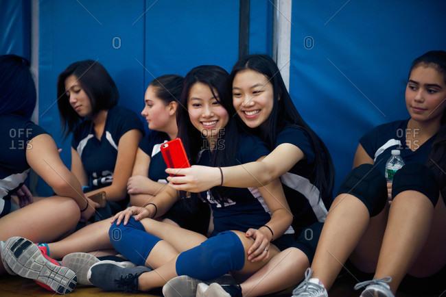 Volleyball teammates taking selfie