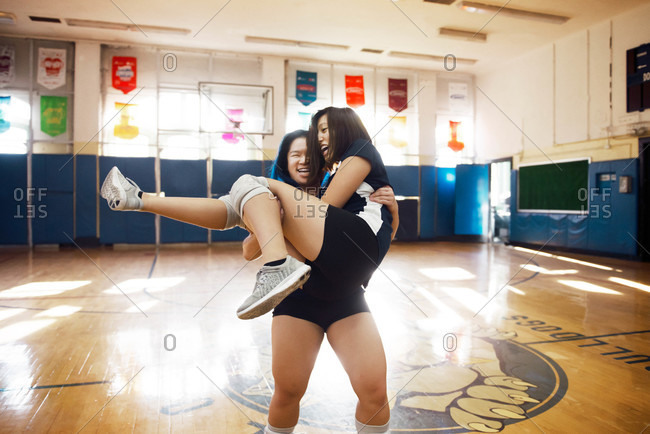 Volleyball player carrying her teammate