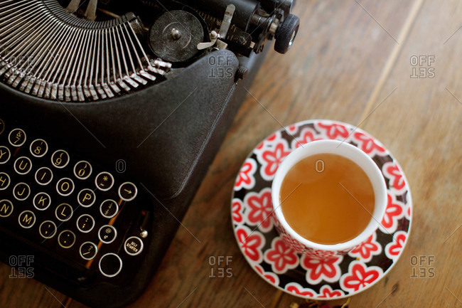 Cup of tea by typewriter