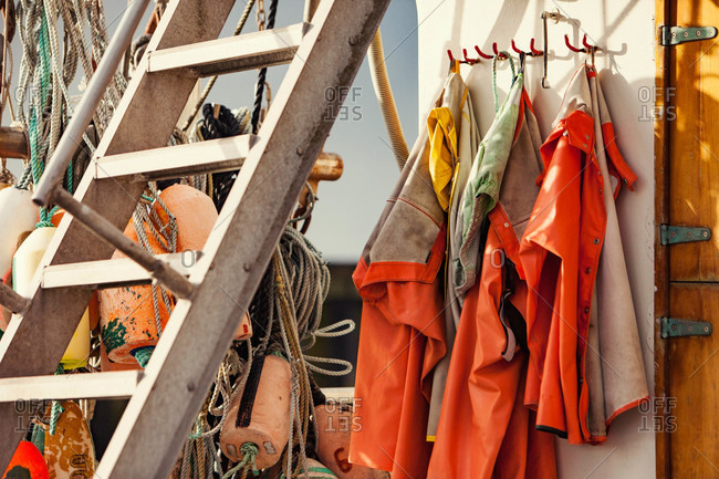 Buoys and coats on a boat deck
