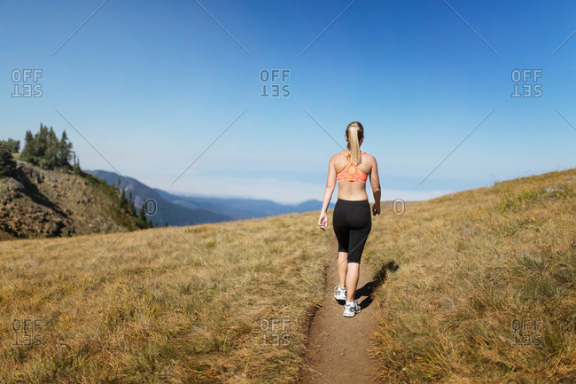 Athletic woman on mountain trail