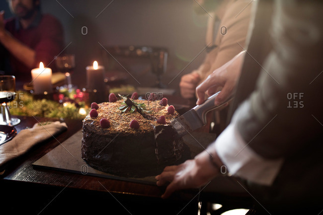 Serving a chocolate raspberry cake at a holiday party