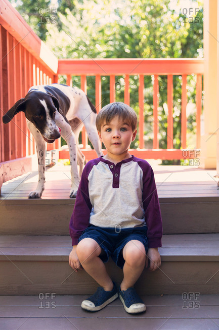 Portrait of little boy and his dog