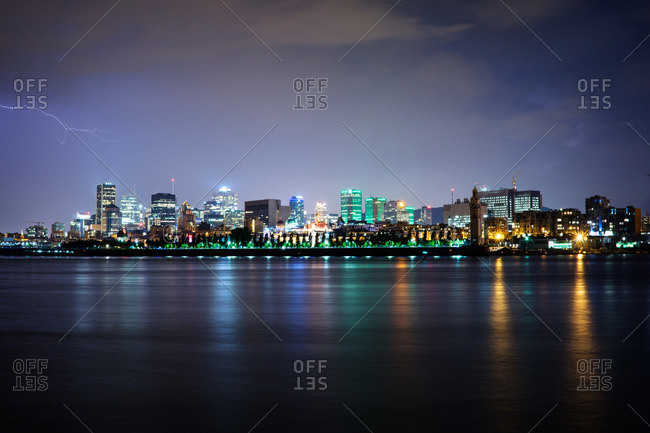 Lightning over the Saint Lawrence River and skyline of Montreal, Canada