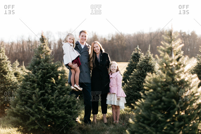 Family portrait at a Christmas tree farm