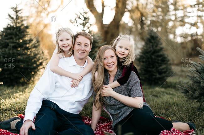 Happy family at a Christmas tree farm