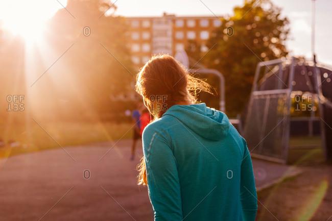 Young woman at an urban park at sunset