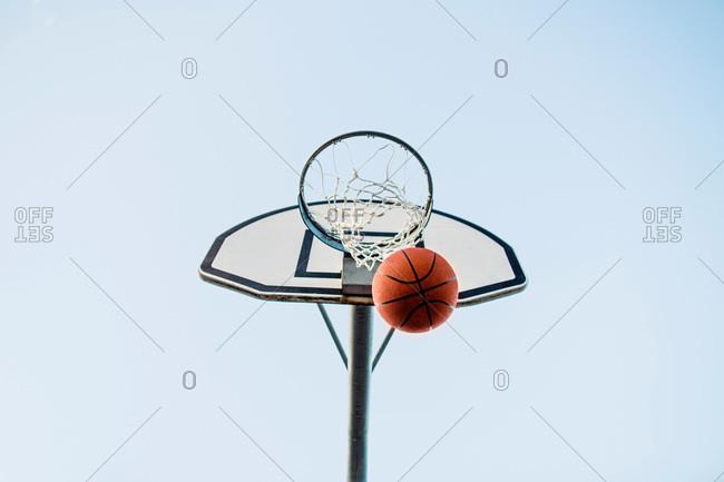 Basketball making a basket through the hoop