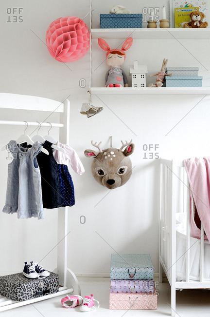 Clothing rack and crib in a child's room