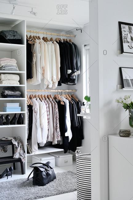 Neutral clothing in a  modern closet