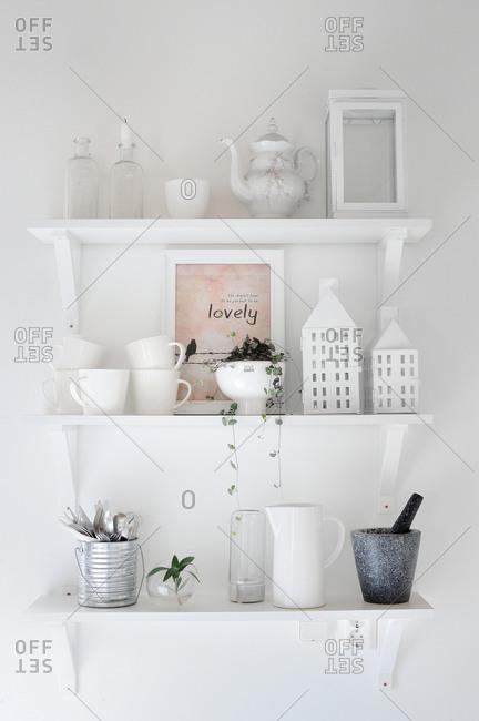 White ceramic ware on floating shelves