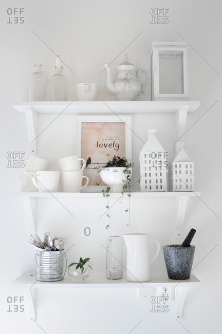 pretty nice 43aa5 afcd3 White ceramic ware on floating shelves stock photo - OFFSET