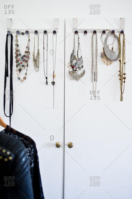 Fashion jewelry hanging on closet doors