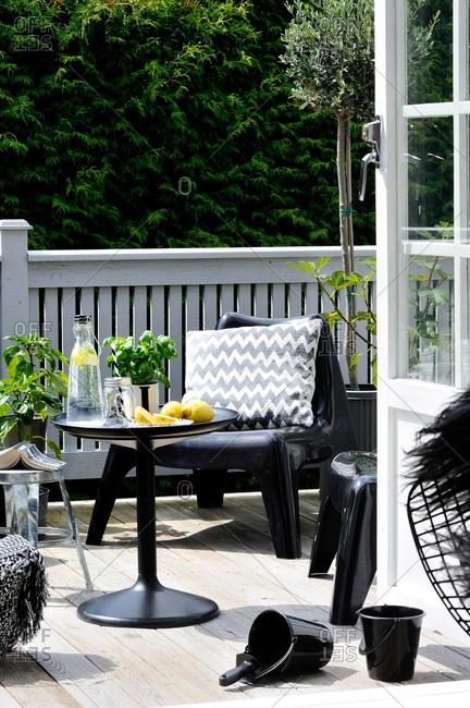 Stylish black patio furniture on a deck