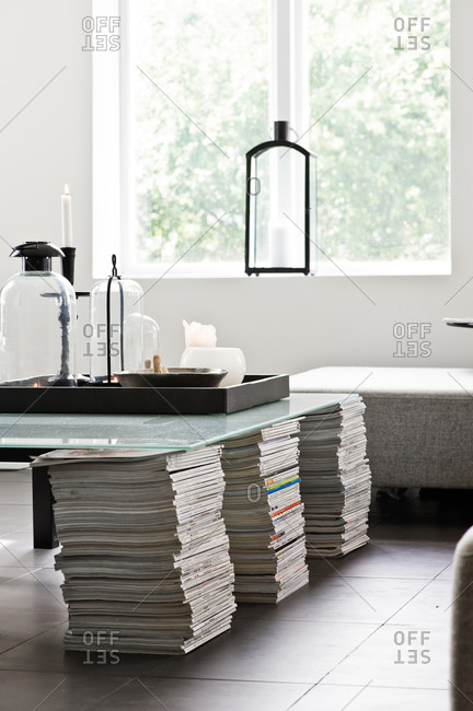 Glass table top on stacks of magazines