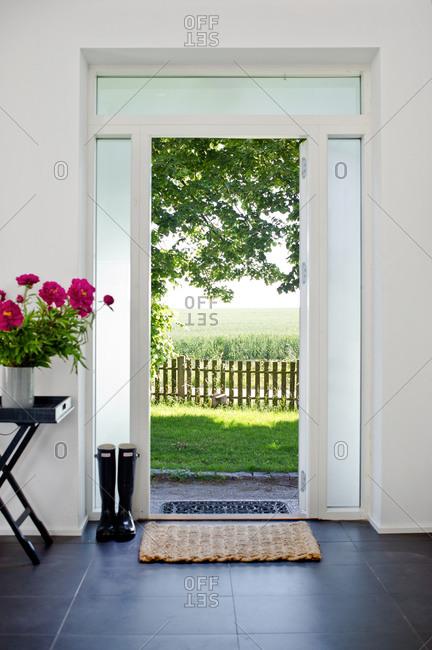 Open front door Hamptons Style Front Offset By Shutterstock Open Front Door With View Of Green Fields Stock Photo Offset