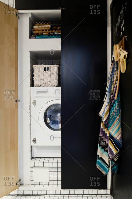 Laundry machine in a modern black cabinet