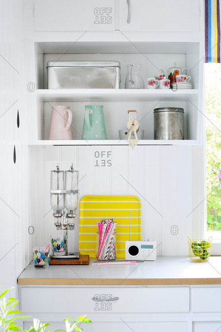 Kitchen accessories on white shelves and counters