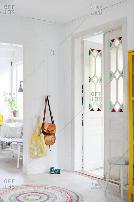 Open stained glass door in an entryway
