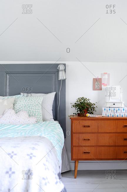 Bed and vintage bedside dresser