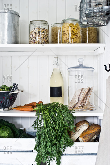 Jars of food in a white rustic pantry