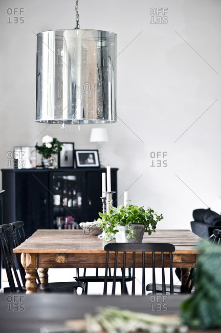 Rustic wooden table and modern light fixture