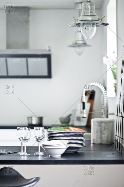 Dishes and wine glasses on a modern kitchen counter