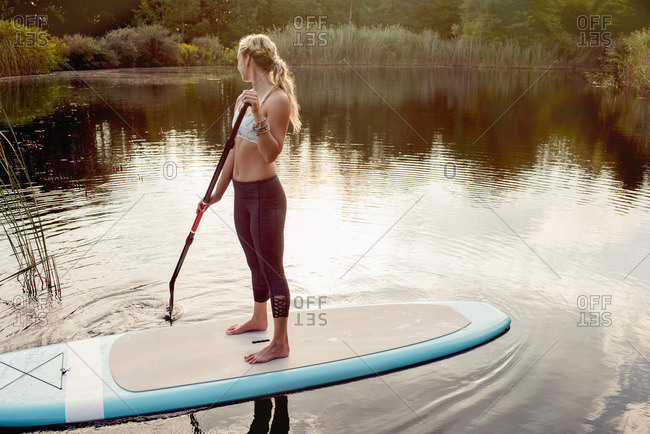 Woman on paddleboard in a lake