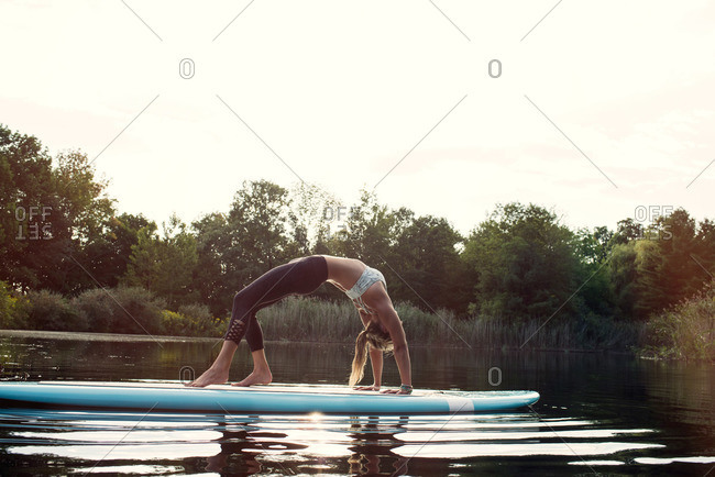 Woman in yoga pose on a paddleboard