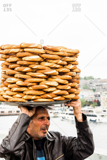 Istanbul, Turkey - May, 2014: Man in Istanbul carrying bread rolls