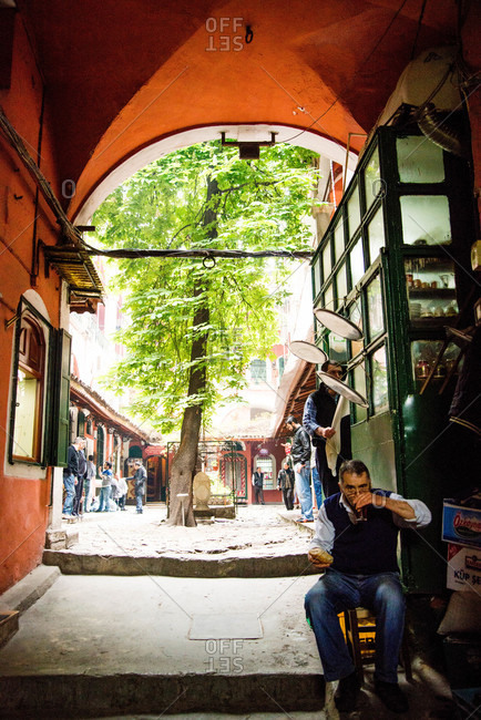 Istanbul, Turkey - May, 2014: Man having a snack near courtyard, Istanbul