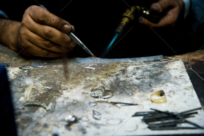 Jewelry maker with blowtorch