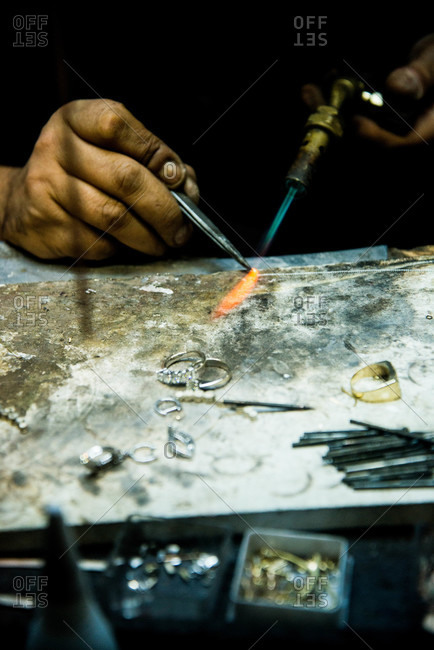 Jewelry maker with a blowtorch