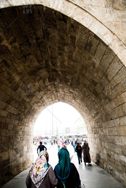 Istanbul, Turkey - May, 2014: Woman in headscarves walking into tunnel, Istanbul