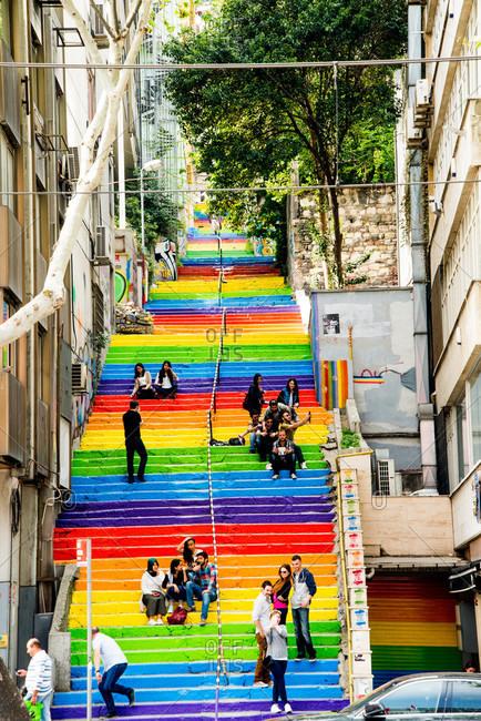 Istanbul, Turkey - May, 2014: People on rainbow painted steps, Istanbul