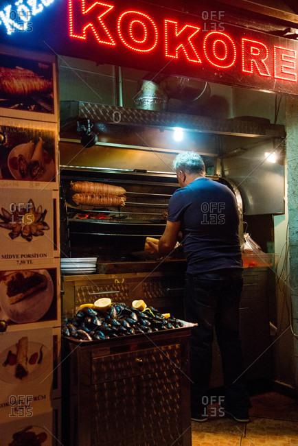 Istanbul, Turkey - May, 2014: Turkish vendor at his food stand